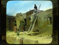 Thumbnail for Walpi - Hopi family about their doorway: B24