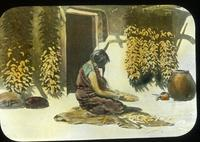 Thumbnail for Hopi woman preparing corn for grinding on metate: C5