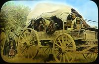 Thumbnail for Navajo women in wagon: E8