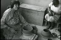 Thumbnail for Pueblo Potter, definitely identified as Maria Martinez, moulding pots. 1936. San Ildefonso: H68