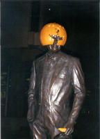 "Thumbnail for 2005 Pumpkin hat Charles Leaming (""Chas"") Tutt statue, decorated."
